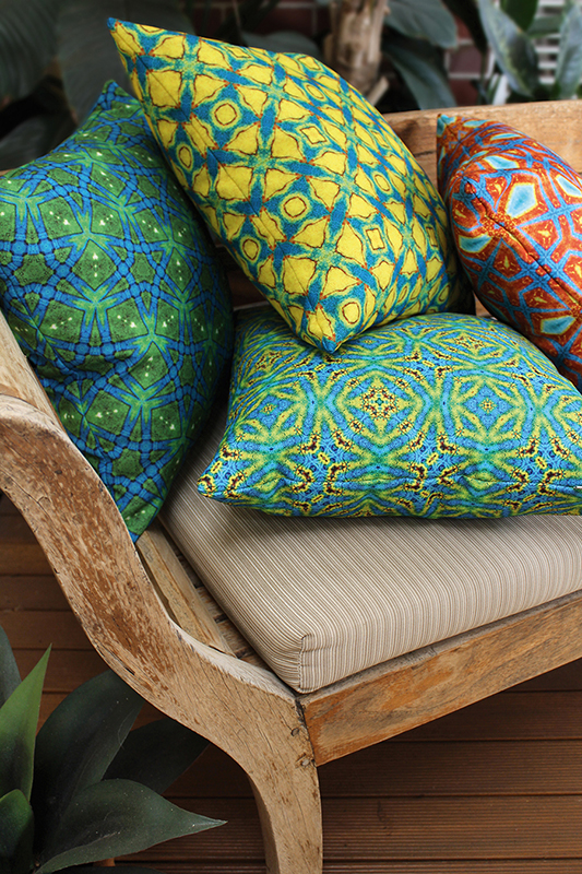 These cushions work together because they are linked by common colours.