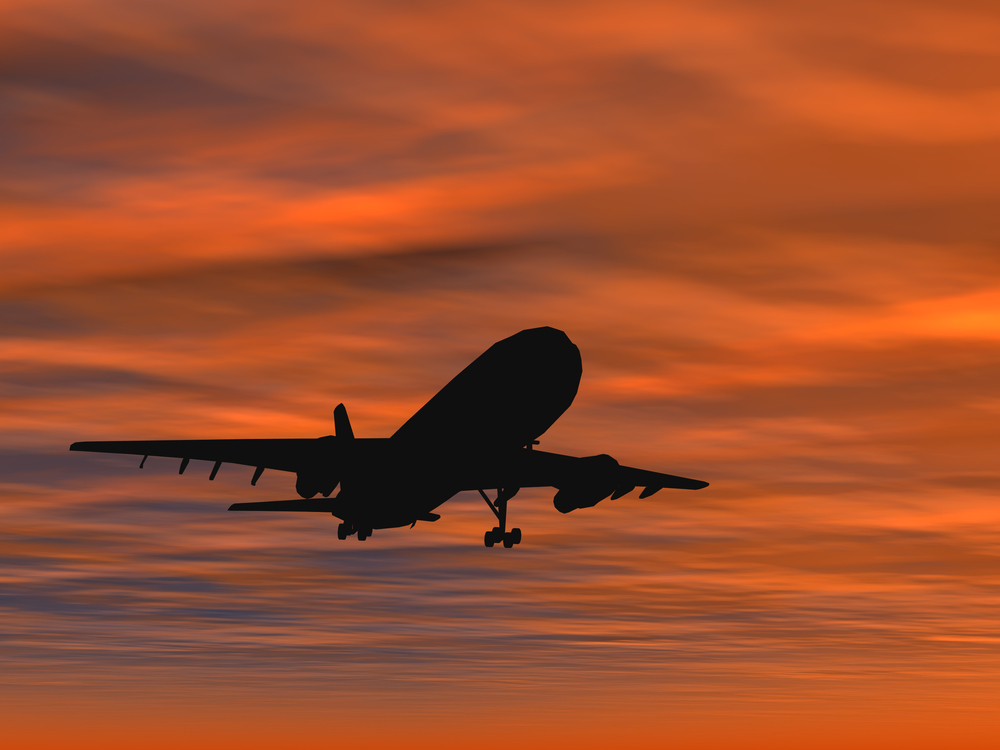 Aircraft in sundown sky Shutterstock.jpg