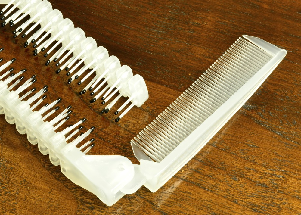 Comb with brush on wood.jpg