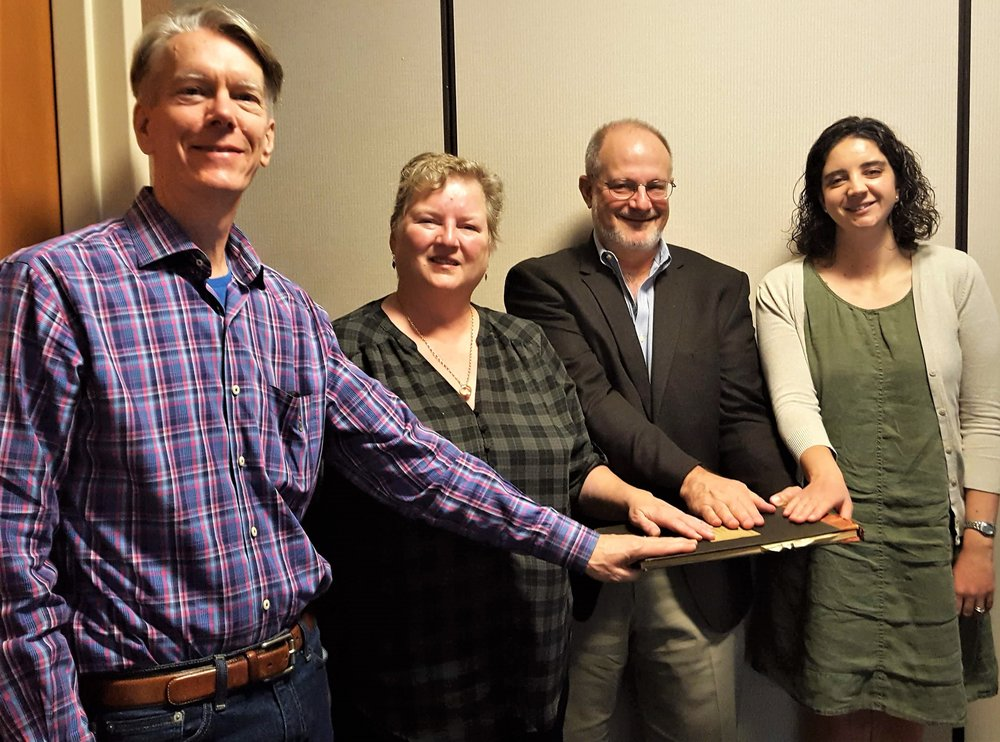 Left to right: Dana Nason, MD, FAAP - Immediate Past President; Carla McKelvey, MD, MPH, FAAP - President; Barry Newman, MD, MBA, FAAP - Treasurer; Alex Butler, MD, FAAP - Vice President, take their pledge on the original 1932 Constitution of the Portland Pediatric Society