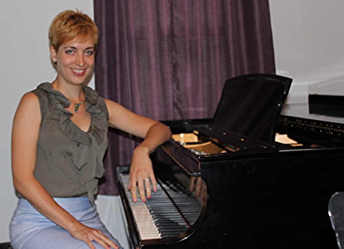 Andrea with her Steinway in her home studio