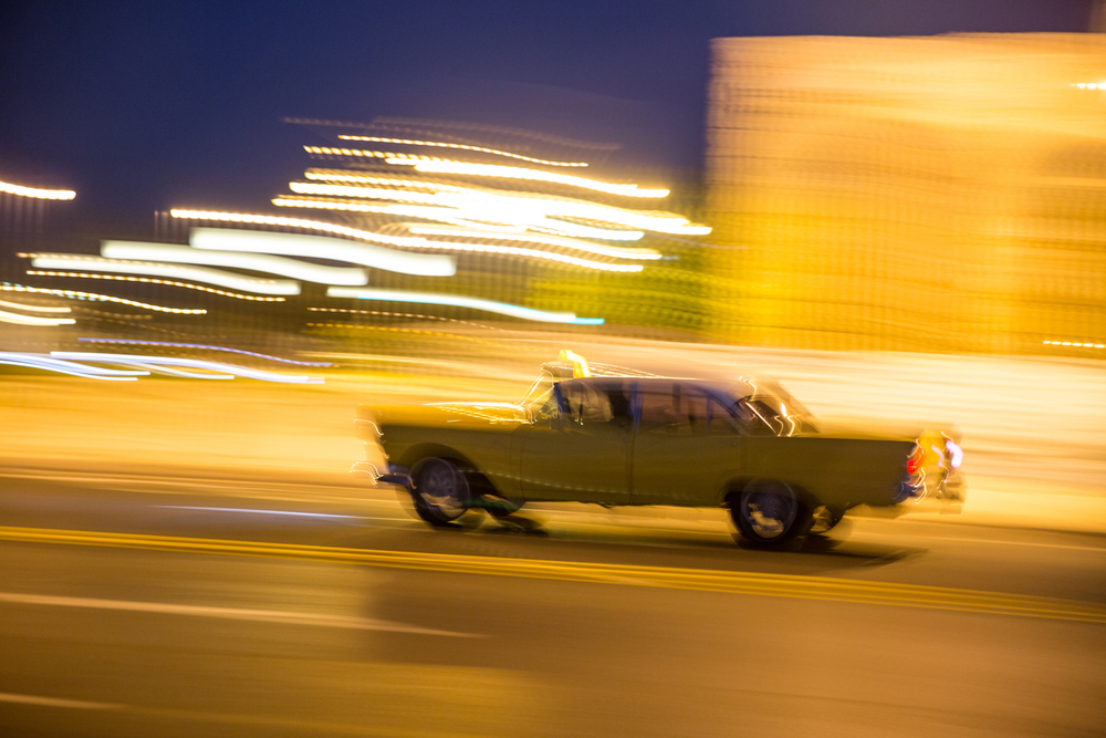 A 1950s American car roars along the Malecón in Havana, Cuba, August 2015.