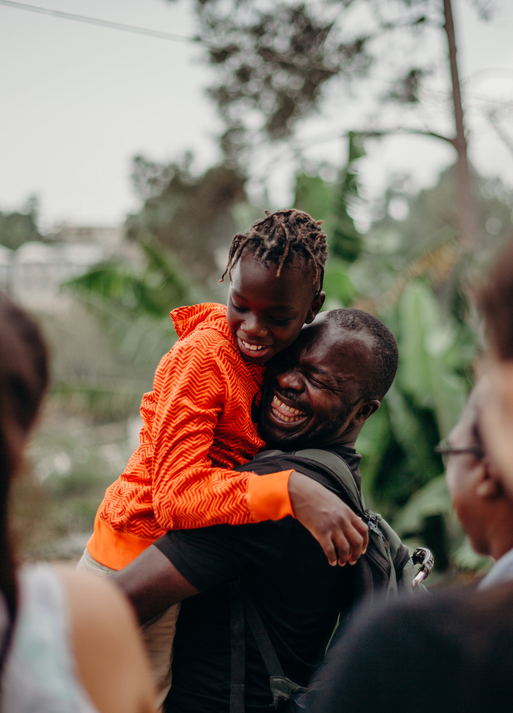 Dinel, the man who first took Alex to the children's home, swept him up in his arms - elated to see him grown and well.