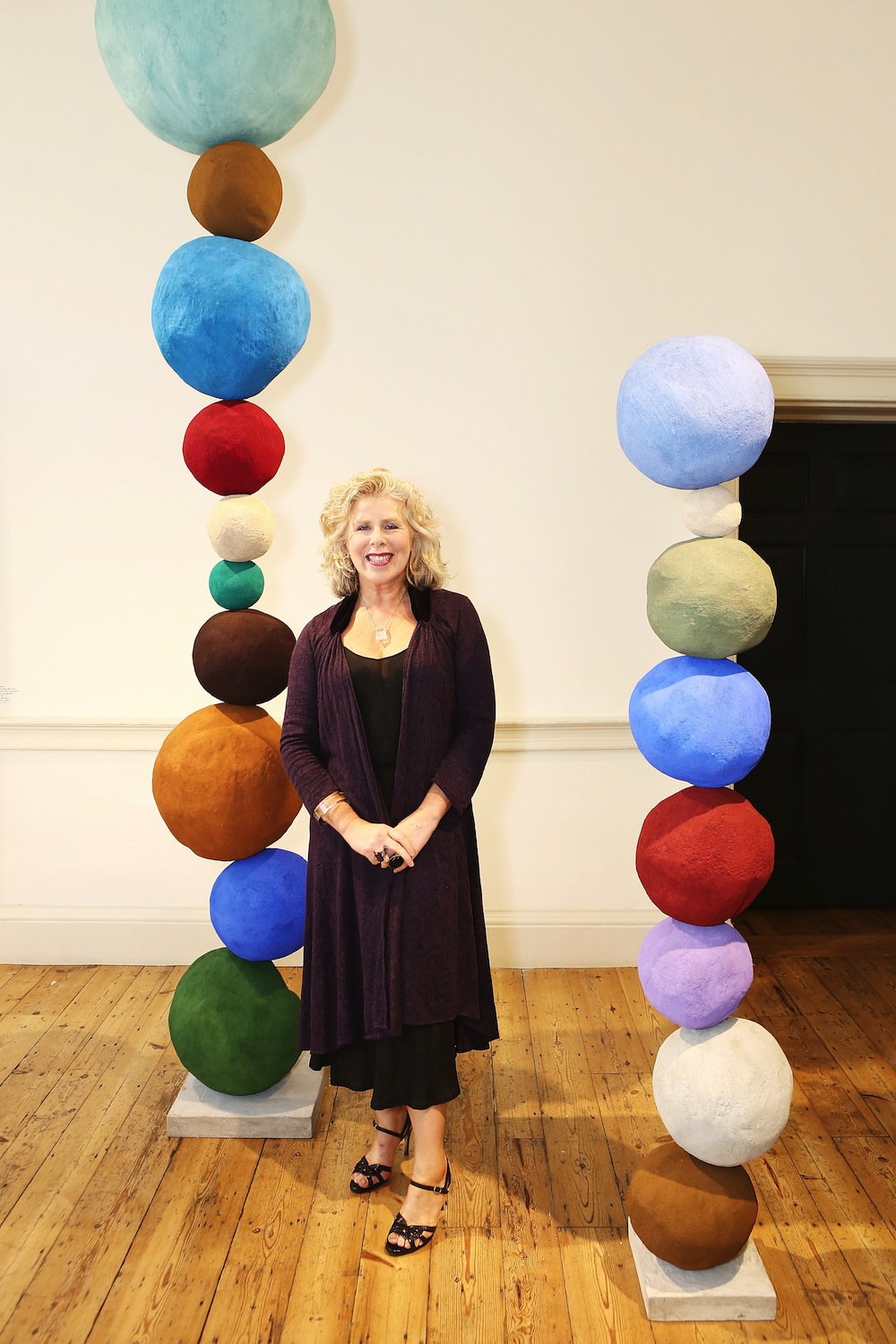 SHARED Curator Kathleen Soriano with stack sculptures by Annie Morris