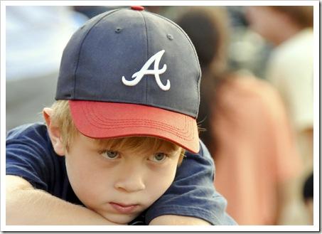 Boy @ championship baseball game