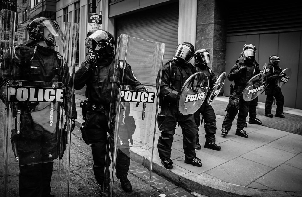 Police riot shields controversy violence protect.jpg