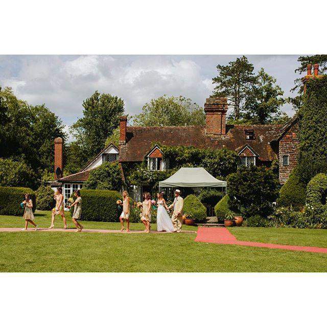 Loving our gold bridesmaid dresses set against this 16th century farmhouse in England... #bridesmaid #gold #bridalparty #wedding #bride #sequins #weddingparty #bohowedding
