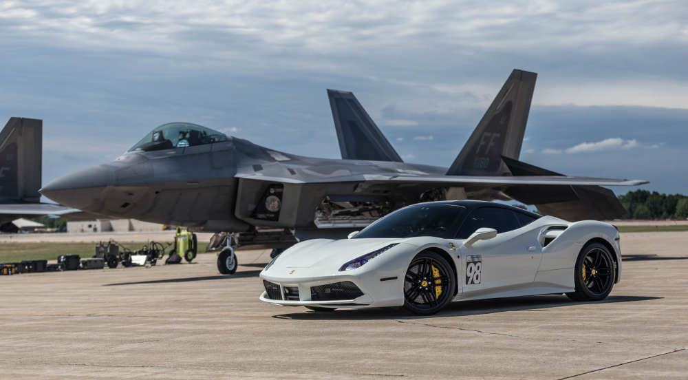 Ferrari 488 posing next to a F-22 Raptor.