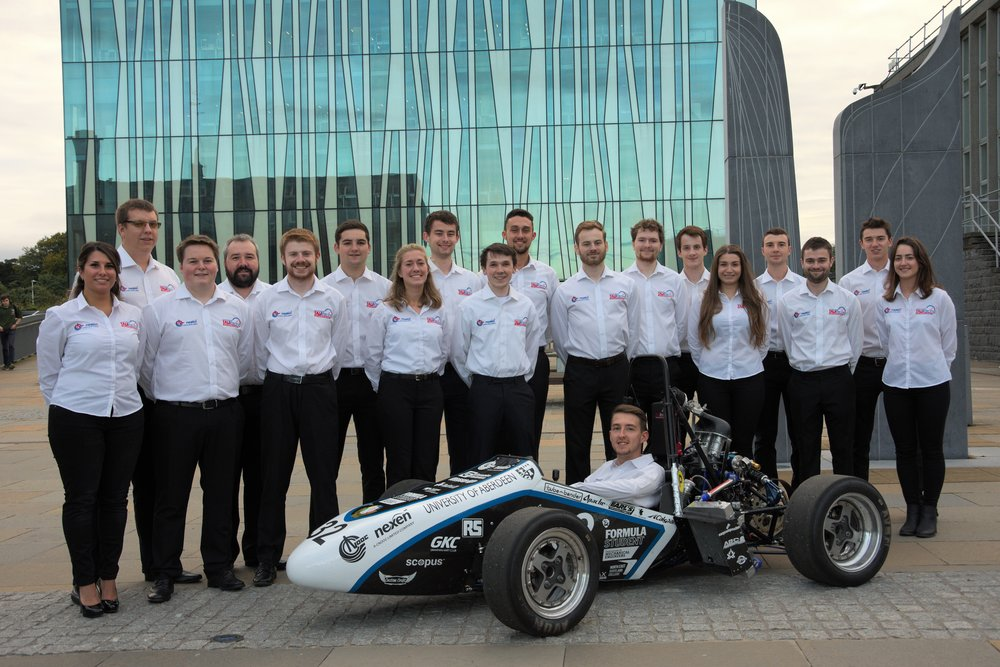 TAU rACING 2017/18 cOMMITTEE with the tau-17 racecar in front of sir Duncan rice library, University of Aberdeen.