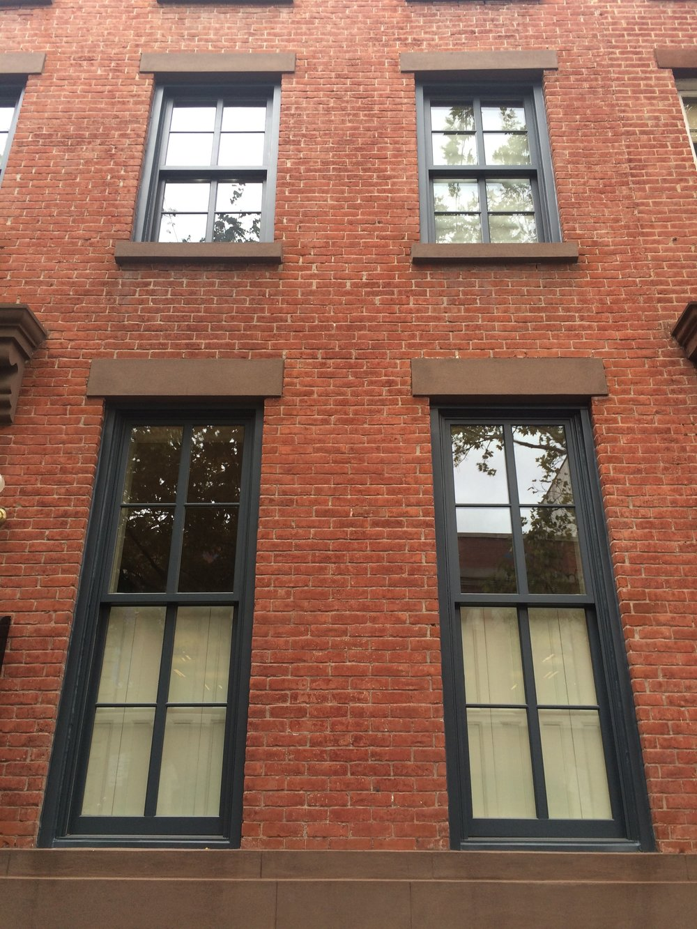 """BEFORE"" window box installation. Window boxes were attached to brick wall and to brownstone."