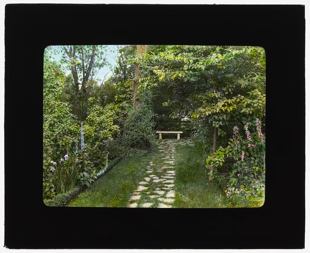 Photograph by Frances Benjamin Johnston of Fanny A. Mulford house, Fulton Avenue, Hempstead, New York. Pathway to bench.  ca 1916.  Library of Congress.   ppmsca 16871  http://hdl.loc.gov/loc.pnp/ppmsca.16871