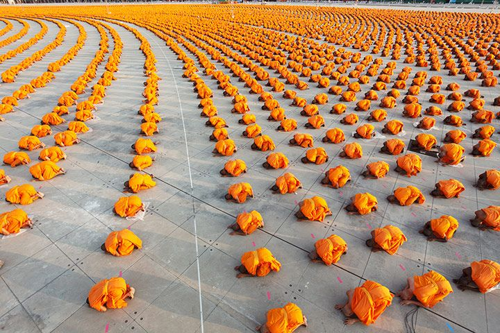 A mass ordination of 34,000 monks at Wat Phra Dhammakaya, a Buddhist temple in Thailand. When I first learned to prostrate, I was surprised that it felt so GOOD.