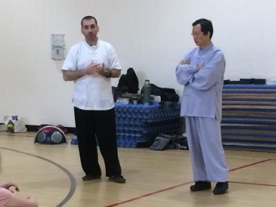 Dr. McCann translating for and assisting his Shifu Wang Fengming during a Taiji and Qigong seminar (Vermont, 2016).