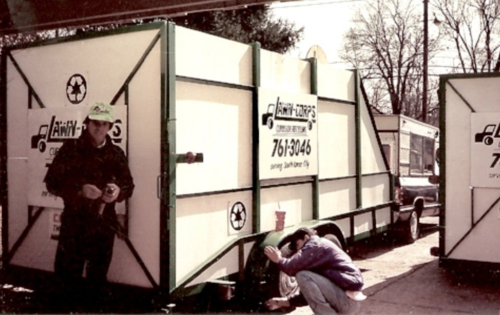 Pat and friend putting the finishing touches on his box trailers. Within 6 months it was necessary to purchase two packer trucks for our curbside pick ups.