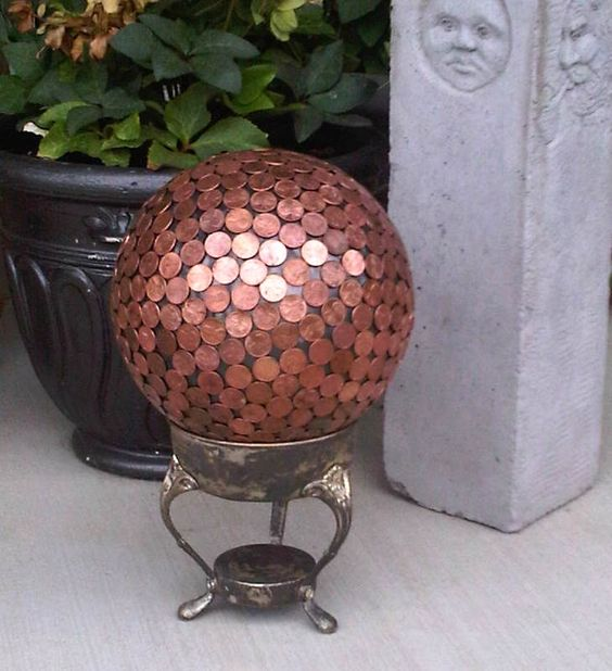 Using E6000 silicone, glue copper pennies to a bowling ball. Make sure to bring it inside during the winter though.