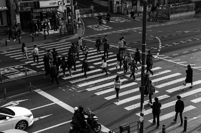Pedestrians crossing traffic light. Hatch Books Blog