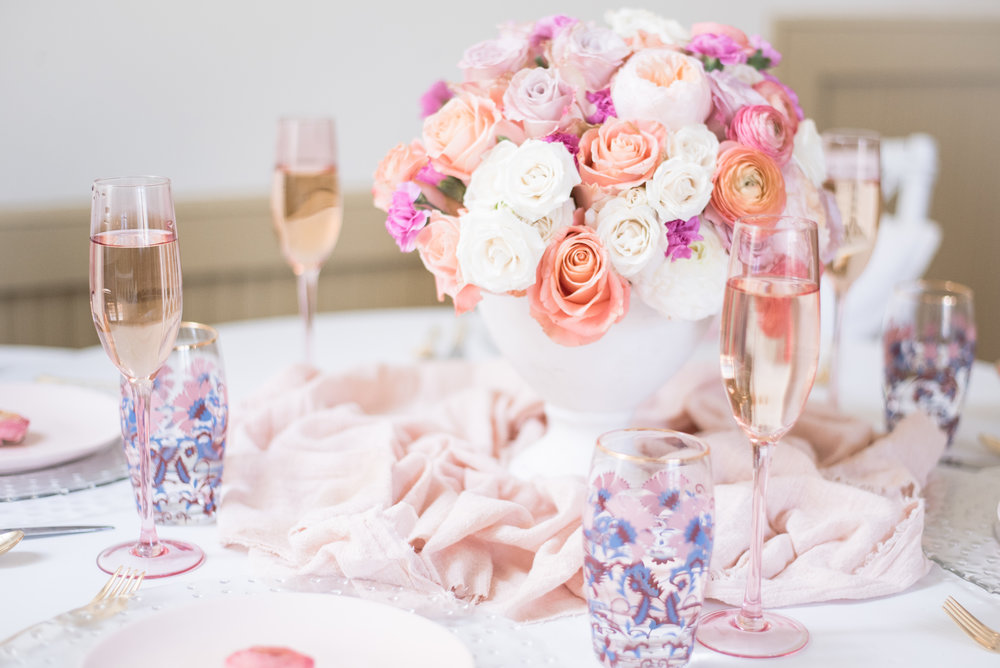 Champagne flutes in a pale shade of blush dress up the place settings, ready for a toast (or two!)