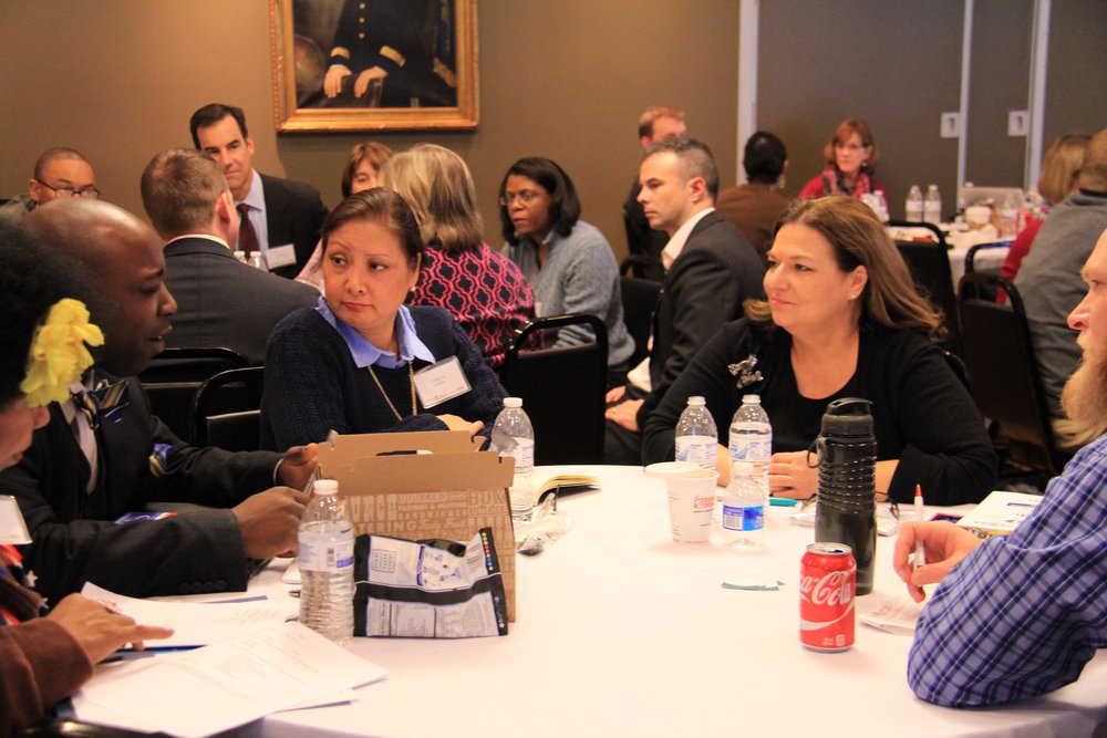 Participants at the Spring 2015 Advanced Candidate Training Workshop review fundraising plans with instructor and fundraising expert Nancy Bocskor