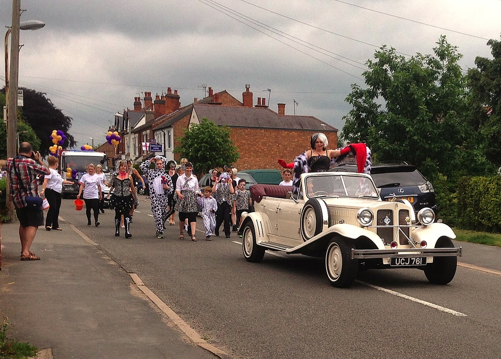 A very different use of the Beauford today. It was Burbage carnival and we were required to head up the procession with Cruella Deville and 101 Dalmations. Lynn stood in the back of the car for the whole 1 1/4hr journey whilst ably performing the part. It transpired she had travelled in the car 12 years ago on her wedding day! Really tricky driving at walking pace. Lots of use of the clutch and freewheeling but we made it to the cheers of hundreds of villagers along the route.