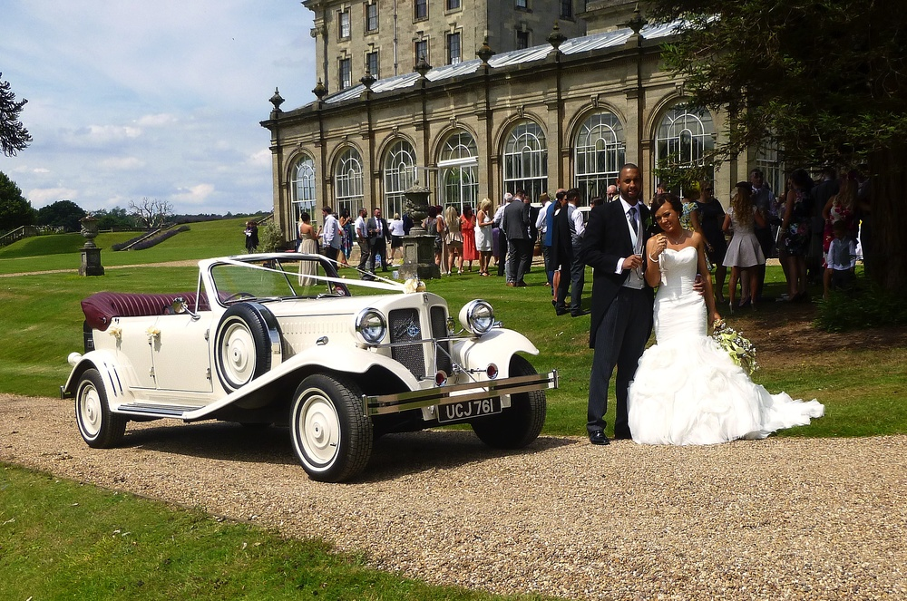 The Orangery at Stoneleigh Abbey. Bride and Groom plus guests, enjoying the hottest day of the year. So far!