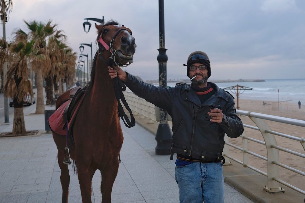 A man and his horse.
