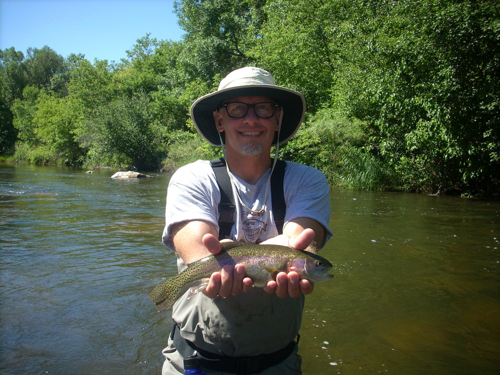 Fly fishing on the Big Thompson River, Colorado.