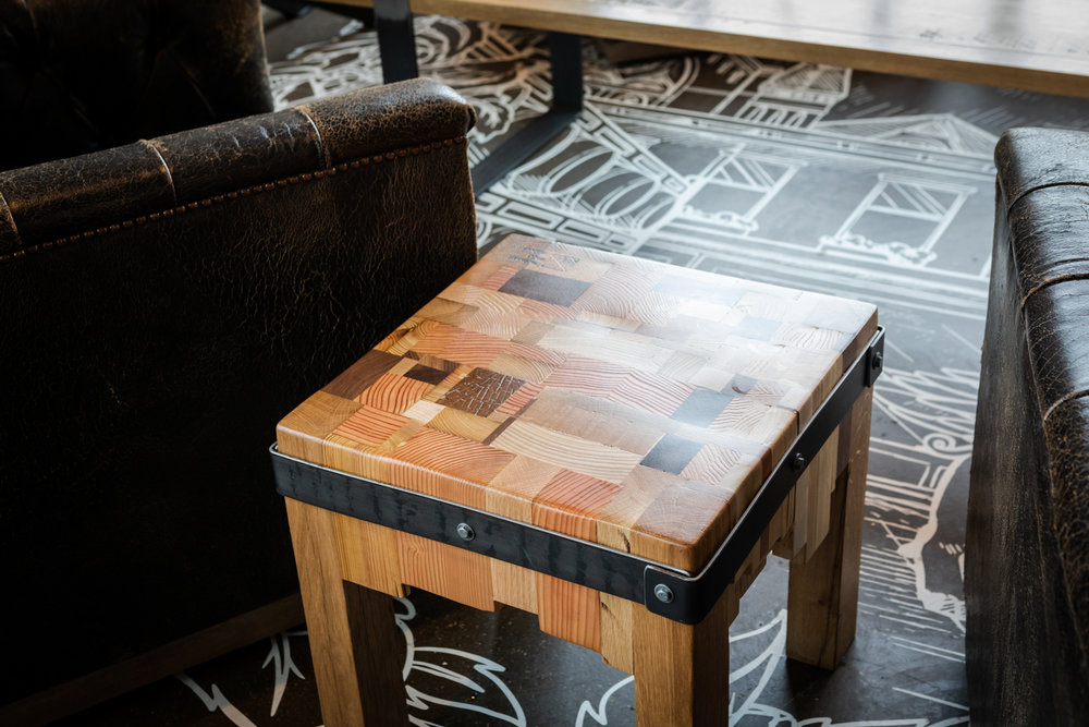 Menagerie Side Table  - End grain tables of various domestic hardwoods and reclaimed softwoods with decorative steel strapping, created by Cincinnati Wood Collaborative.