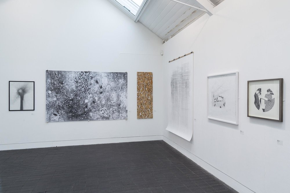 Punchcard (2015) 50x50 cm, pencil on paper (right). Installation shot courtesy of Jerwood and photographer Hydar Dewachi, 2016.