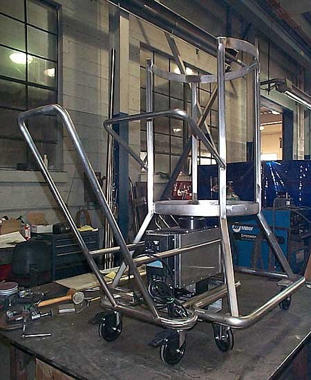 Stainless steel cart for a bottom mixer designed and fabricated by AAA Welding & Fabrication for St. Gobain and the University of Tennessee.