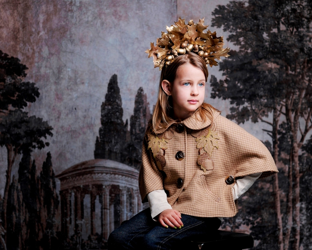 Bridget channels an Oak Queen in our Little Acorn Capelet, detailed with textural acorn and leaf embroidery.