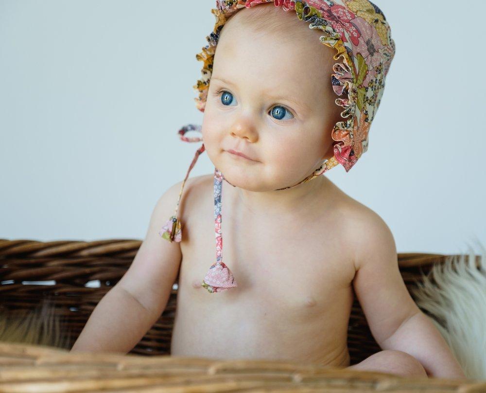 Mauvey Ruffle Bonnet on Model.jpg