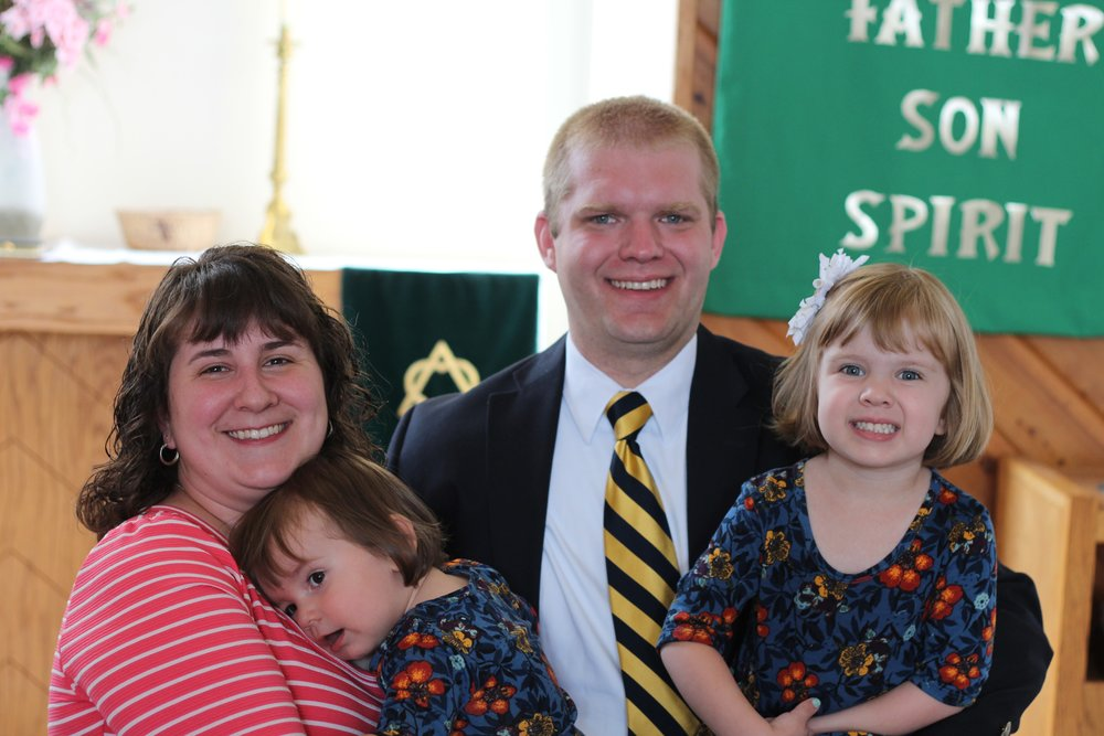 Pastor Georgson, his wife Linden, and their two daughters Isabelle and Adaline.