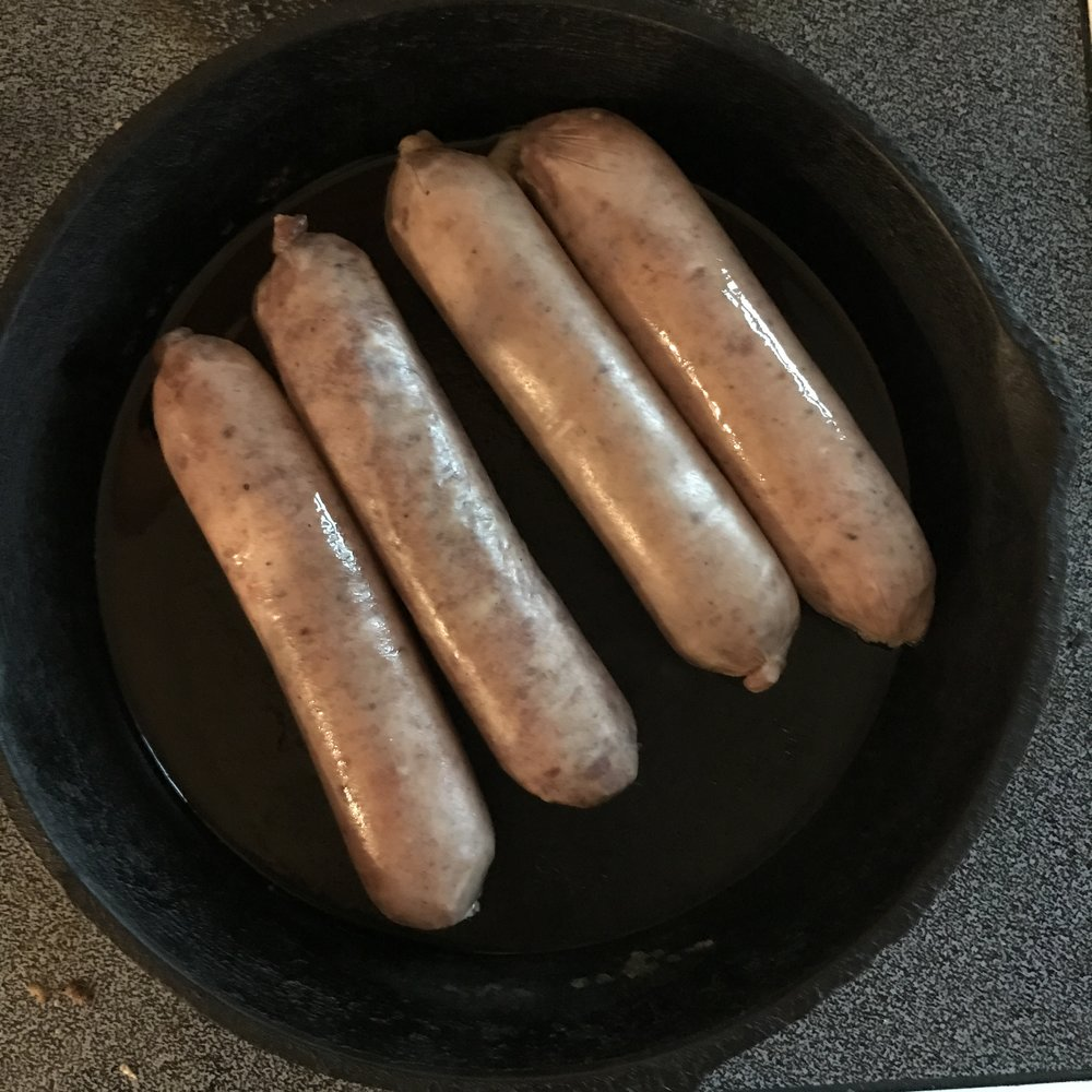 Start with completely defrosted sausages and an oven-safe skillet on medium high heat. Also preheat your oven to 375 degrees