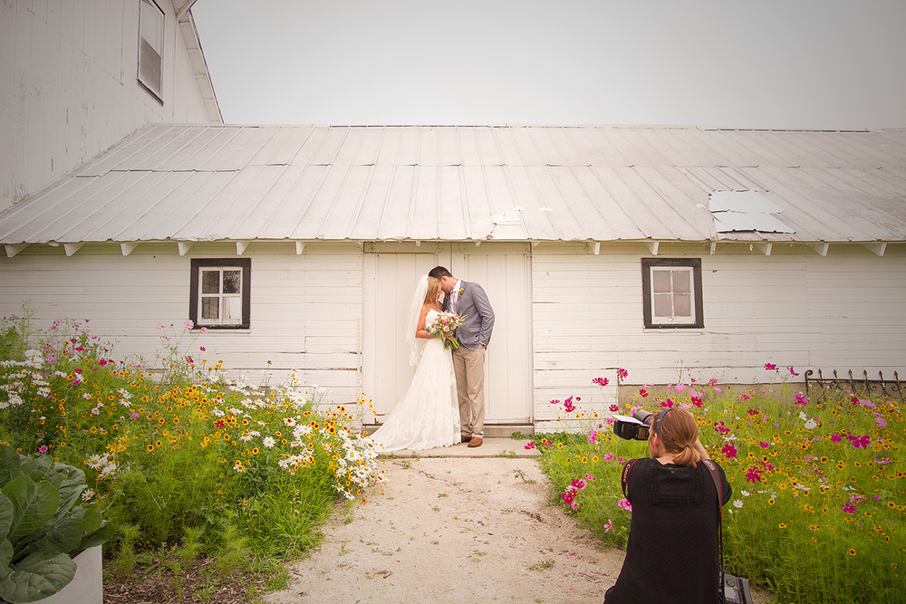 Caitlin shooting the bride and groom at Heritage Prairie Farms in Elburn, IL
