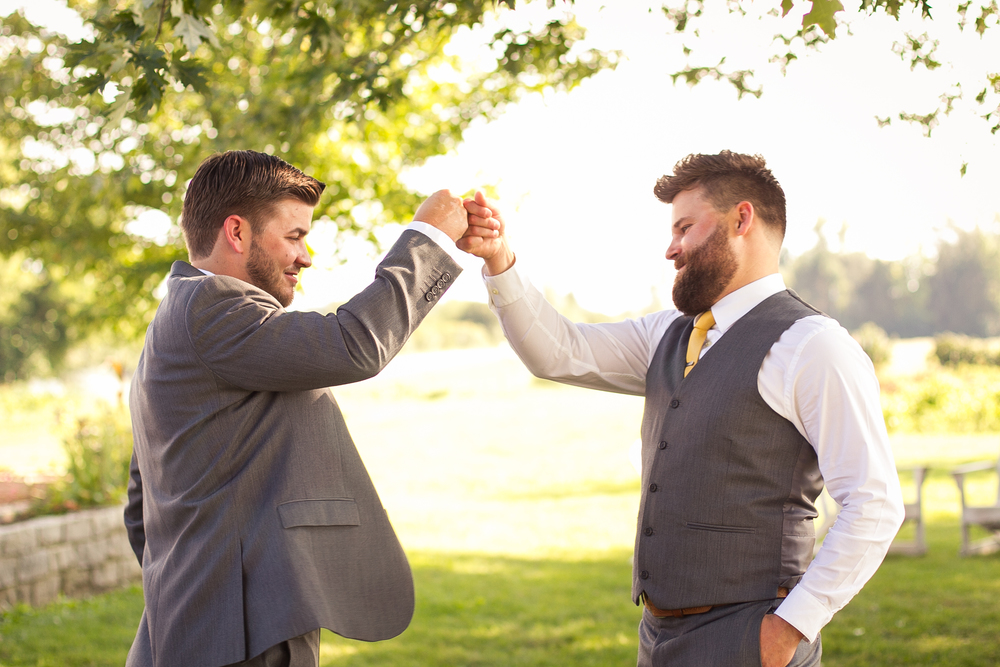 fist bump with groomsmen