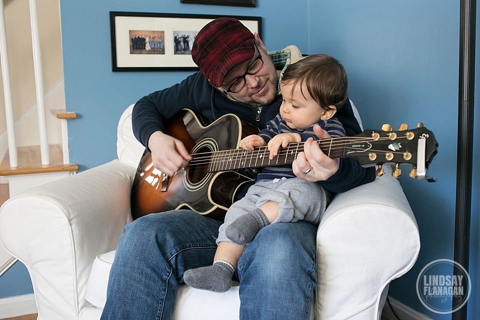 Josh attempts to teach Henry the guitar at 11 months old