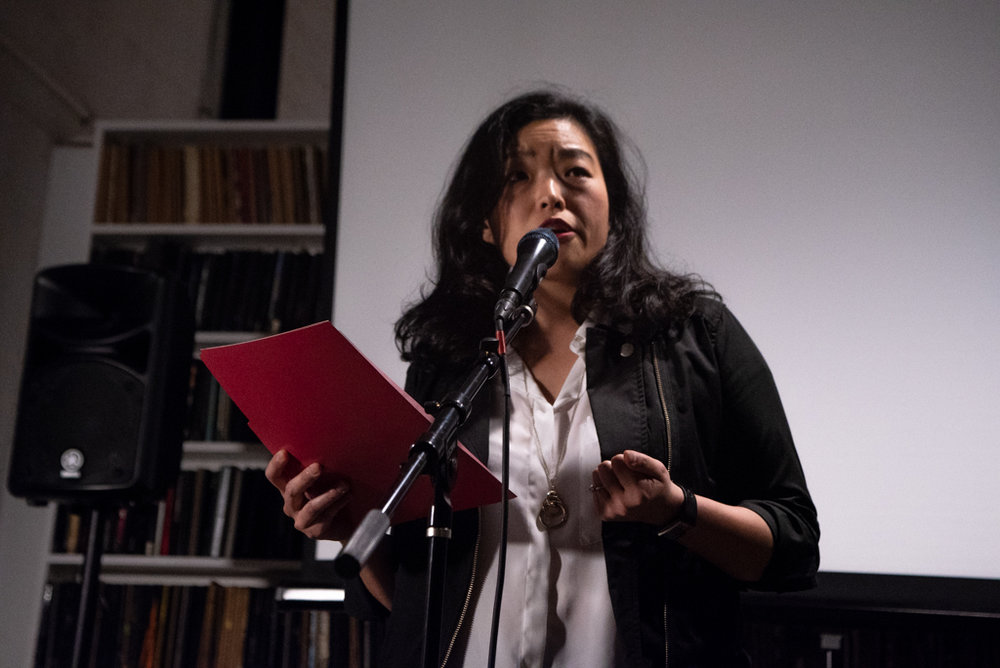 Patricia reading her essay at the Burn The Book premiere on April 19. Photo by Bridget Haggerty.