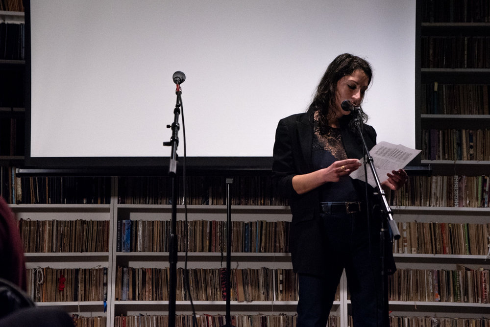 Hannah reading her essay at the Burn The Book premiere on April 19. Photo by Bridget Haggerty.