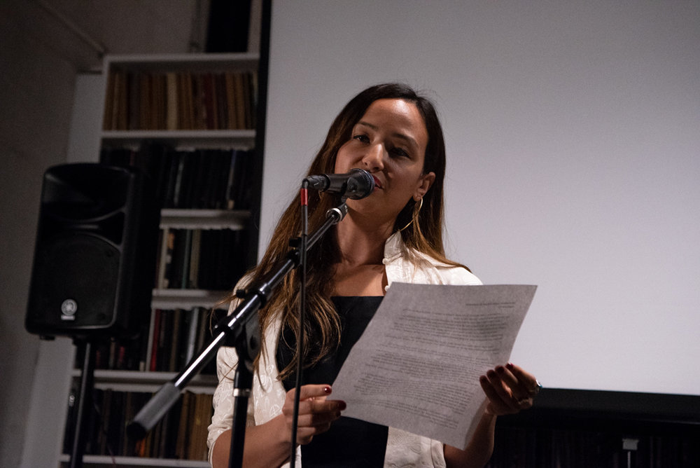Kyle reading her essay at the Burn The Book premiere on April 19. Photo by Bridget Haggerty.