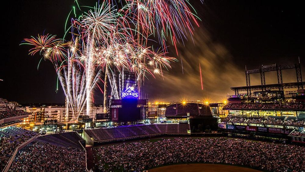 One of the many spectacular Fourth of July fireworks shows in Denver at Rockies Stadium  (  courtesy of The Denver Patriot)