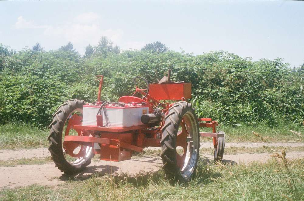 A 1950's era gas powered Allis Chalmers Model G has been converted to run off of a bank of batteries.