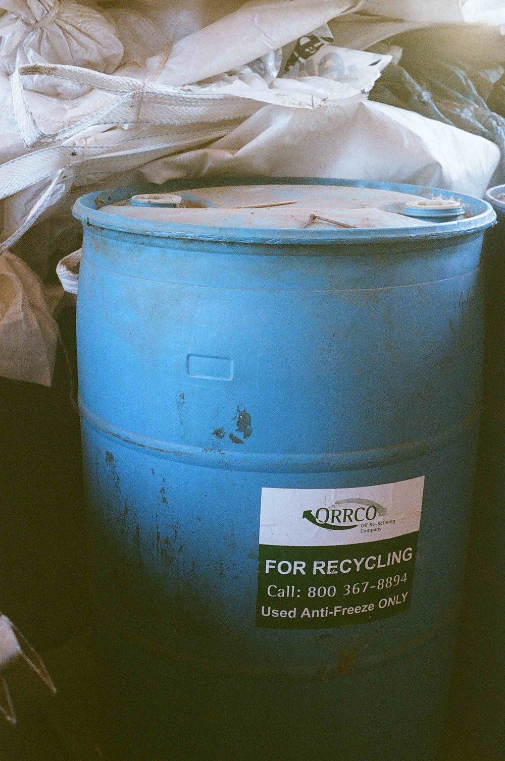 Used anti freeze is stored in a barrel before transporting it to a recycling facility.