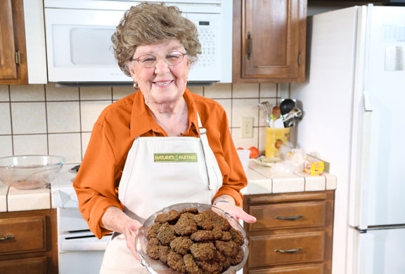 Mrs. Helen Krause displays her Hachiya Persimmon Oatmeal Cookies.  Download high resolution image here.