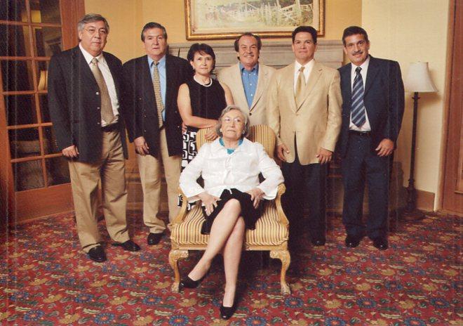 This photo of the Podesta family shows Vita (front center) and Enrique (far left).