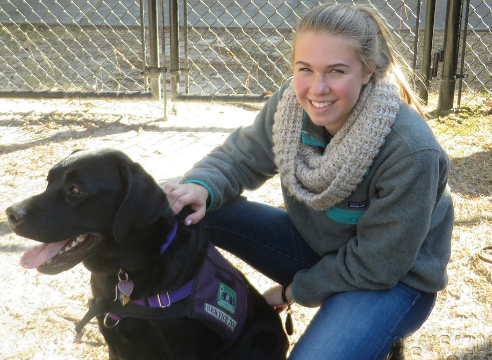 Meredith Butenhoff, who has Ehlers-Danlos Syndrome, with her service dog, Sami, who received his training from Palmetto Animal Assisted Life Services.