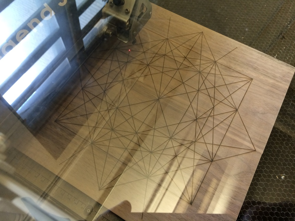 laser etching/cutting the design on the top face