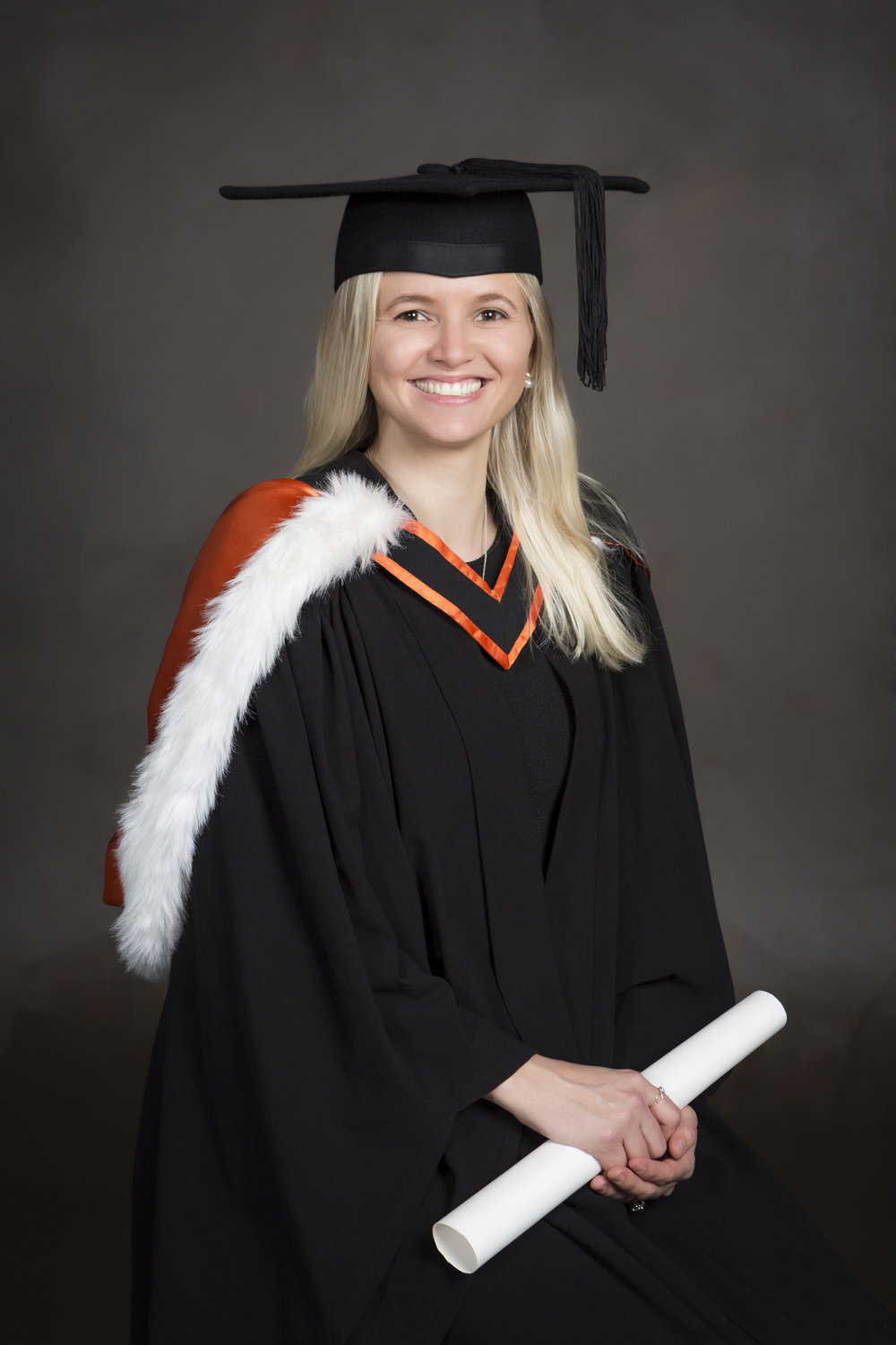 Dress: hat level with ground, fringe hidden, V 10cm down from neck, hood off right shoulder with colour showing. Hold scroll half way along.