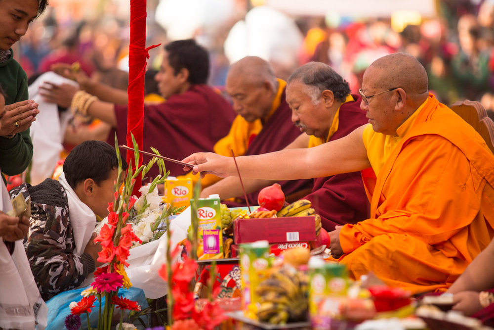 Buddhist monks receive gifts of food from followers.
