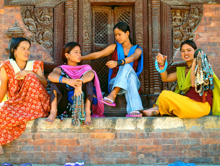 Nepalese women selling beaded jewelry.