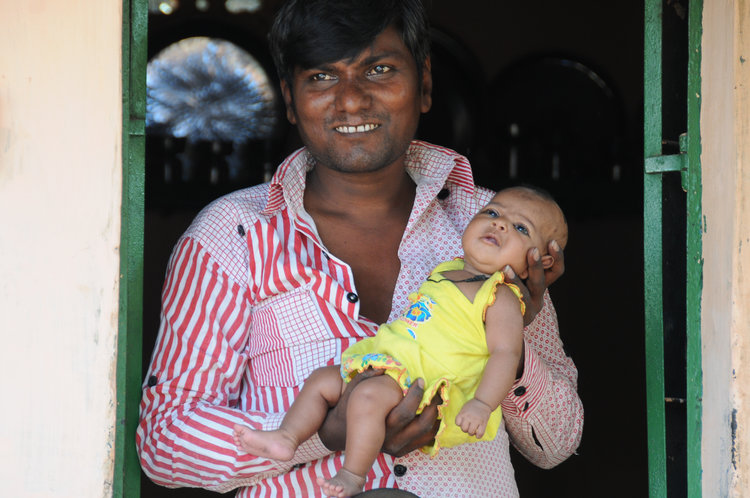 NW INDIA: a father allows a LIFE International volunteer to take a photo of his beautiful baby.